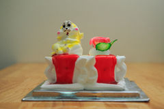 view of big light birthday cake with rabbit on wooden table Royalty Free Stock Photography