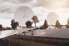 View of a big long range communication antenna and Solar panel. Stock Photos