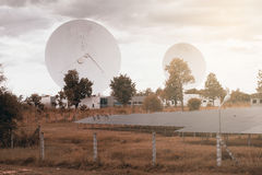 View of a big long range communication antenna and Solar panel. Stock Photography