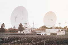 View of a big long range communication antenna and Solar panel. Royalty Free Stock Photos