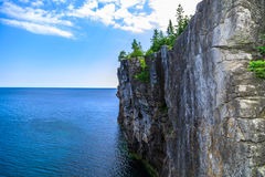 View of big long rocky cliff standing in Cyprus lake against blue bright sky background Royalty Free Stock Photography