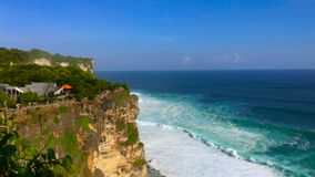 View on big ocean waves at the Uluwatu Temple, Pura Luhur Uluwatu, at the Bali island, Indonesia.  stock video