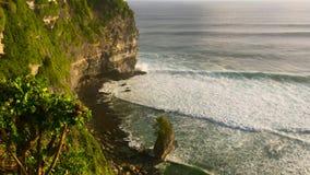 View on big ocean waves at the Uluwatu Temple, Pura Luhur Uluwatu, at the Bali island, Indonesia.  stock video footage