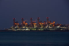 View of big oil refinery on a night sky background Stock Photography