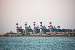 View of big oil refinery on a sky background Stock Photos