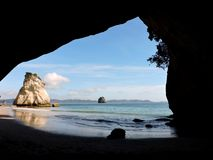 Cave on the beach stock images