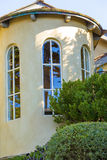 VIew of the big stone house tower with large windows Royalty Free Stock Photography