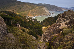View Big Sur Pacific Ocean California. Mountaintop view of ocean homes at Big Sur on the Pacific Coast of California royalty free stock image