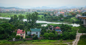 View of the Binh village with river, green grass, cloudy sky Royalty Free Stock Images