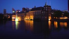 Binnenhof - Dutch Parliament, Holland. View of Binnenhof - Dutch Parliament at night over Hofvijver pond at night, Hague Holland stock video footage