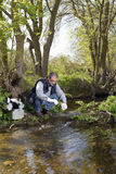 View of a Biologist take a sample in a river. Stock Image