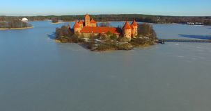 View from bird flight of Trakai old castle. Aerial shot of Trakai old castle and Galve lake, Lithuania stock footage