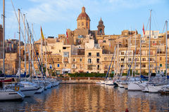 View of Birgu with Our Lady of Annunciation Church over the Dock Stock Photography