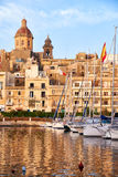 View of Birgu with Our Lady of Annunciation Church over the Dock Royalty Free Stock Image