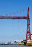 View of the Biscay Bridge. Gecho's (Getxo) region with a blue sky and the city n the background. Bilbao, Spain Royalty Free Stock Photography
