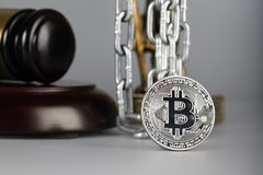 View at bitcoin. Statue of Themis in the background. View at bitcoin. Statue of Themis and metallic chain in the background.Closeup stock photography
