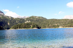 View of the Black Lake and the mountain Durmitor in Montenegro Stock Photo