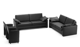 A view of a black leathered sofa. Isolated on white background stock photo
