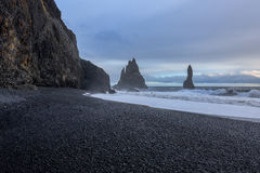 View of the black sand and rough sea at the beach Royalty Free Stock Photo
