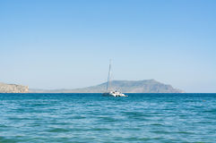 View of the Black Sea bay and moored yacht in summer, Crimea, Ukraine Royalty Free Stock Photos