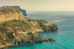 View of Black Sea from the cape Fiolent at sunset, near Sevastopol, Crimea peninsula. Picturesque sea landscape in HDR Royalty Free Stock Photo