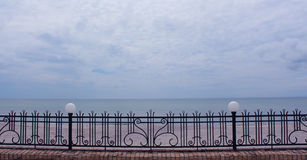 View of Black Sea through the metal fence. Close up Royalty Free Stock Photography