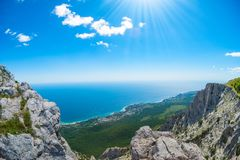 View of the Black Sea from Mount Ai-Petri. Below the village of Alupka Big Yalta. Cloudy sunny weather.  royalty free stock image