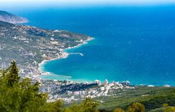 View of the Black Sea from Mount Ai-Petri. Below the village of Alupka Big Yalta. Cloudy sunny weather.  stock image