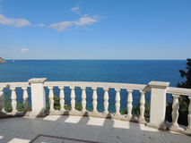 Views of the Black sea.. View of the Black Sea from the site of the Rotunda in the Seaside Park of Partenit, Crimea. Classic white balustrade. Paradise Park in Royalty Free Stock Photos