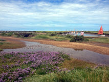 Blakeney Quay, Norfolk. Blakeney Quay lies within Blakeney National Nature Reserve situated near to the villages of Blakeney, Morston and Cley next to the sea on Royalty Free Stock Photos