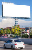 View of blank billboard beside street for public advertisement d Royalty Free Stock Photos