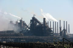 View on the blast furnace. Industrial smoke in sky Stock Images