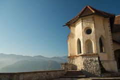 View from Bled Castle. In the distance Julian Alps with Triglav. In front, part of the wall and castle Stock Images