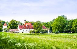 Blooming flower in front of castle Blutenburg in Munich - German royalty free stock photos