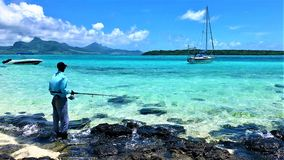 Scenic view on blue bay lagoon mauritius with fisher royalty free stock image