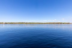 View with blue deep river and horizon line. View with blue river and horizon line stock photography