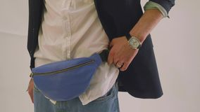 View of blue fanny pack on waist of male model during photoshoot stock video
