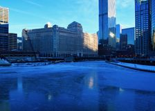 View of a blue and freshly frozen Chicago River during frigid morning. View over a blue and frozen Chicago River during frigid morning of below zero January royalty free stock photos