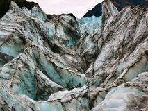 Cold, jagged ice on Fox Glacier, New Zealand stock images