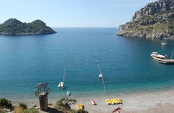 View on blue lagoon with clear water, small green island and ple Stock Photography