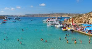 View of the Blue Lagoon on Comino island of Malta. Comino, Malta - September 28, 2013. View of the Blue Lagoon on Comino island of Malta, with people, cruise Stock Photos