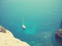 View on the blue Mediterranean sea from the rocky south coast of Malta. Image filtered in faded, retro, Instagram style with extremely soft focus; nostalgic Royalty Free Stock Photo