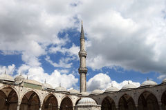 View of Blue Mosque courtyard and minaret Stock Photography