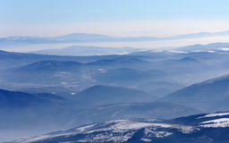 A view of blue mountain hills with snow Stock Photography