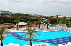 View of the blue pool and the beach in a Turkish hotel. Stock Photography