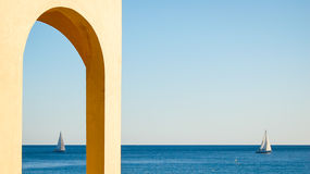 View of blue sea and sky in varigotti from an arch Stock Photos