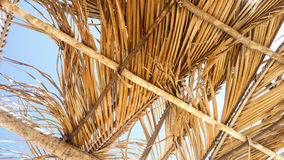 View on blue sky through beach shack roof Royalty Free Stock Photo