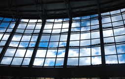 View of blue sky with clouds from glass wall Royalty Free Stock Images