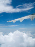 View of blue sky and jet plane wing Royalty Free Stock Photos