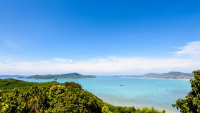 View blue sky over the Andaman Sea in Phuket, Thailand. High angle view blue sky over the Andaman Sea and seaside tourist town from Khao-Khad mountain viewpoint Stock Images